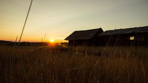 Sunset over old broken wooden houses Footage