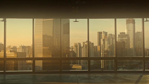 view modern urban architecture in dust,dusk sun pass through window Footage