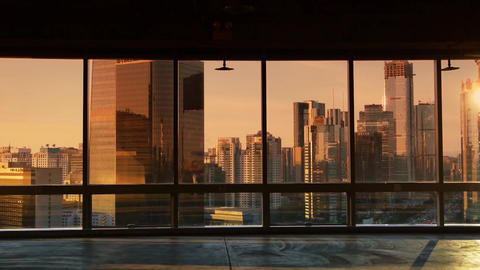 view modern urban architecture in dusk,sun pass through... Stock Video Footage