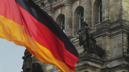German flag flapping and detail of Reichstag building in... Stock Video Footage