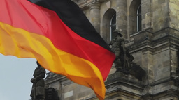 German flag flapping and detail of Reichstag building in Berlin Footage