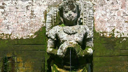 Hindu Goddesses statues making religious offerings. Goa Gajah, Bali. Indonesia Footage