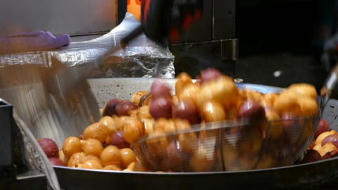 Preparing small donuts on night market in Tainan Live Action