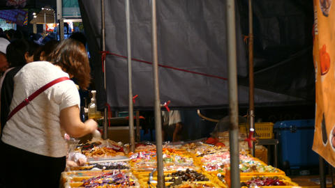 Lots of candy on night market in Tainan Live Action