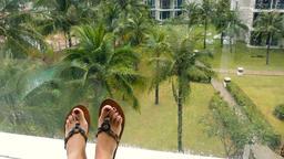 Female feet against tropical scene Live Action