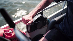 Man Adjusting Power Controls On Powerful Boat Live Action