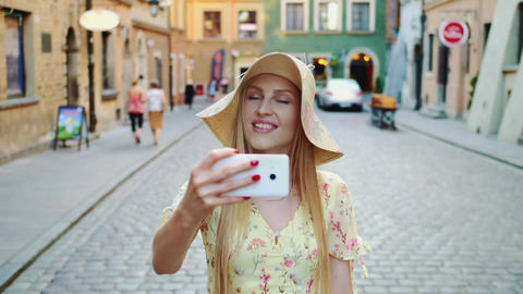 Woman sightseeing and taking shots. Cheerful girl sightseeing and taking shots Live Action