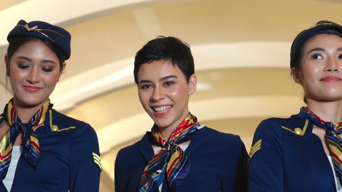 Cabin crew dancing with joy in airplane Live Action