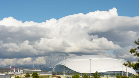 Thick rainclouds swirling over Bolshoy Ice Dome, Sochi. Time-lapse Live Action
