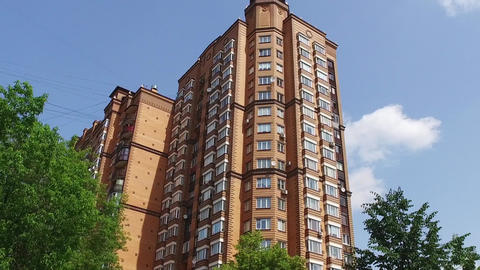 Apartment building brick color in city at summer Footage