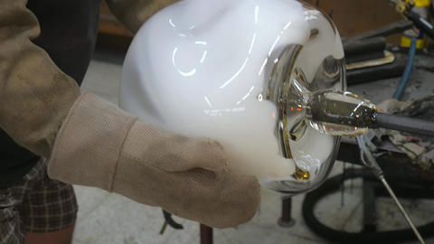 Process of breaking off a finished glass vase from a glass pipe. Glass handicraft Live Action