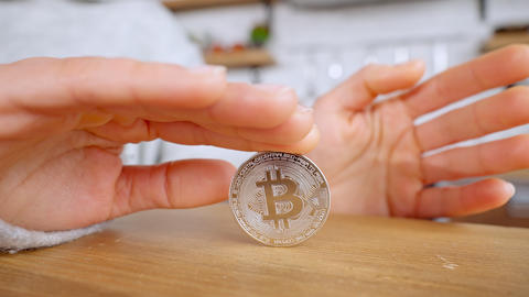person holds symbol of digital currency Live Action
