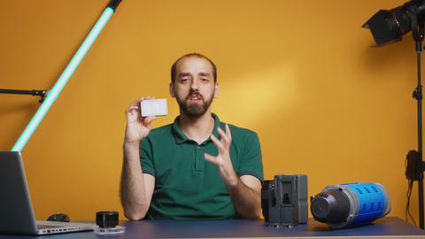 Videographer reviewing mini led led Live Action