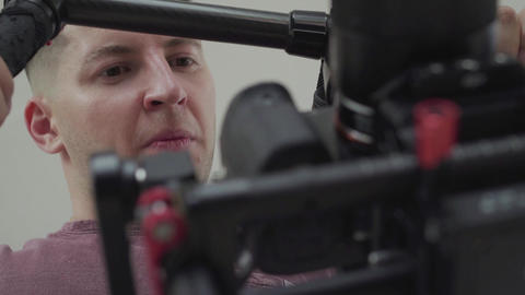 Videographer shoots with a stabilizer in the studio. Camera Gimbal DSLR Video Live Action