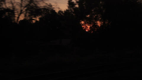 Sunrise Through Window Moving Train Silhouettes Footage