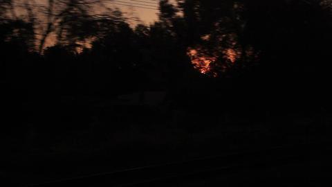 Sunrise Through Window Moving Train Silhouettes Footage