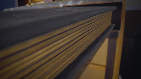 Old book open on a wooden table. Book with wooden pages, close-up Live Action