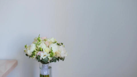 Wedding bouquet in a glass vase on the stairs near the wall. Camera moving Live Action