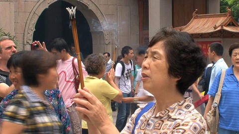 Woman pray Jing'an Temple Stock Video Footage