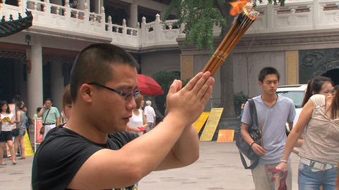 man praying at the Jing'an Temple Footage