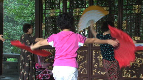 Chinese people dancing with chinese fan Footage