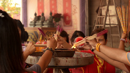 Thai People Lighting Incense Sticks at a Temple Footage