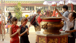 Two Thai Women Praying on the Eve of Chinese New Year ภาพวิดีโอ
