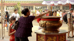 Two Thai Women Praying on the Eve of Chinese New Year Stock Video Footage