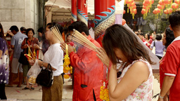 Thai People Praying at a Temple Footage