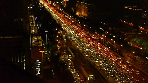 long cars troop on busy overpass,aerial view of night... Stock Video Footage