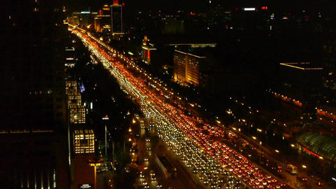 long cars troop on busy overpass,aerial view of night traffic pollution in city Footage