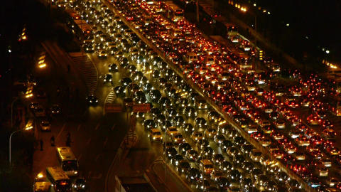 cars jam troop on busy overpass,night traffic pollution in Beijing Footage