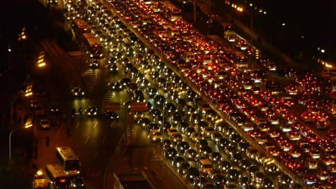 cars jam troop on busy overpass,night traffic pollution... Stock Video Footage