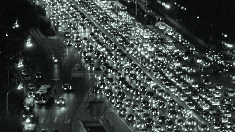 cars jam troop on busy overpass,night traffic pollution in city Footage