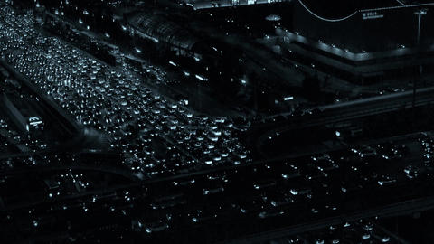 cars jam troop slow moving on busy overpass,nighttime traffic pollution in city Footage