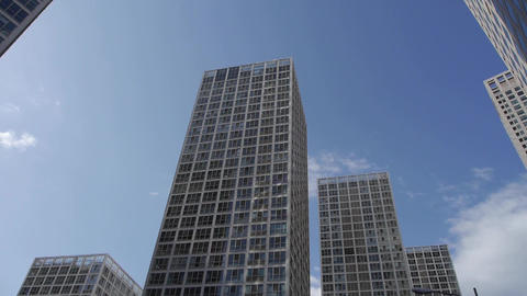 Rotate camera lens of tall office buildings Stock Video Footage