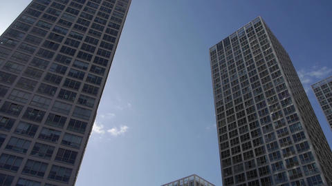 Rotate camera lens of tall office buildings Footage