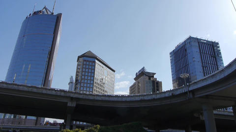 busy overpass traffic & CBD tall business office... Stock Video Footage