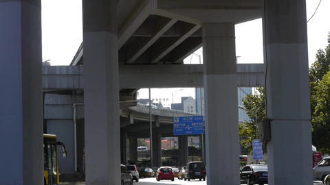 downtown traffic,under overpass in Beijing Stock Video Footage