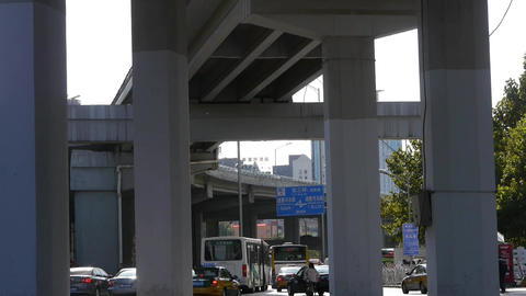 downtown traffic,under overpass in Beijing Stock Video Footage