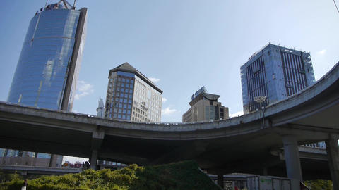 busy overpass traffic & CBD tall business office buildings in Beijing China Footage