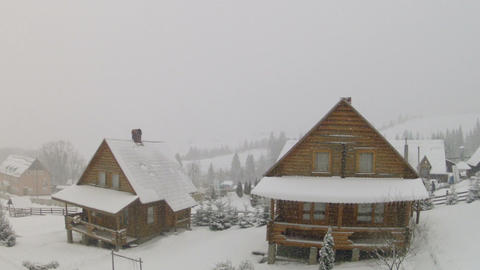 Wooden houses and falling snow with moving camera Stock Video Footage