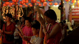 Mother and Son Praying Together at Temple on Chinese New Year Footage