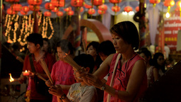 Mother and Son Praying Together at Temple on Chinese New... Stock Video Footage