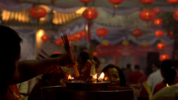 People Lighting Incense Sticks at a Temple at Night Stock Video Footage