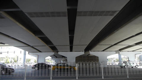 traffic under overpass in city Stock Video Footage