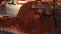 Chocolate making equipment with flowing cocoa Stock Video Footage