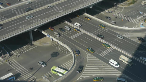 Aerial view of crosswalk & overpass traffic at an... Stock Video Footage