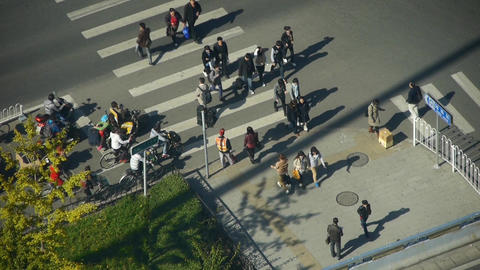 Aerial view of timelapse crosswalk & traffic at an... Stock Video Footage