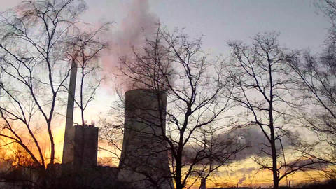 Ride alongside past a power plant Stock Video Footage